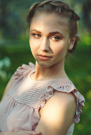 tress: Beautiful girl with makeup and hairdo with tress, summertime. Stock Photo