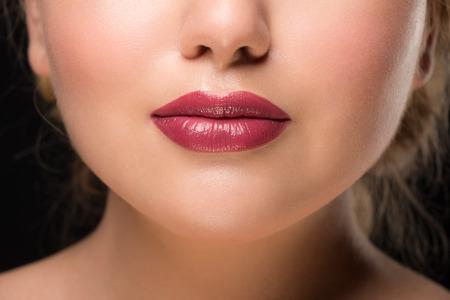 Closeup of beautiful sexy plump woman lips with lipstick