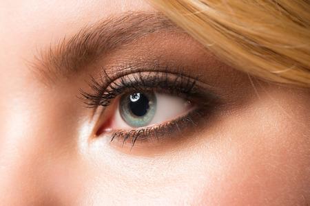 young eyes: Closeup image of beautiful woman eye with makeup Stock Photo