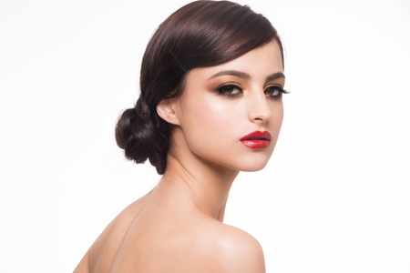 brown eyes: Portrait of young beautiful woman with fashion makeup. Makeup with golden eyeshadow and red lips Stock Photo