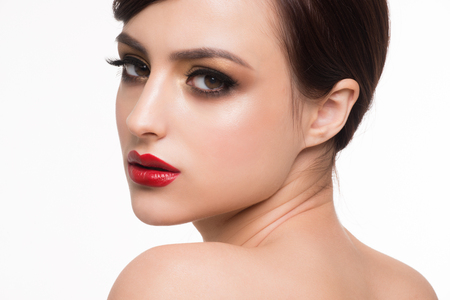 lips: Portrait of young beautiful woman with fashion makeup. Makeup with golden eyeshadow and red lips Stock Photo