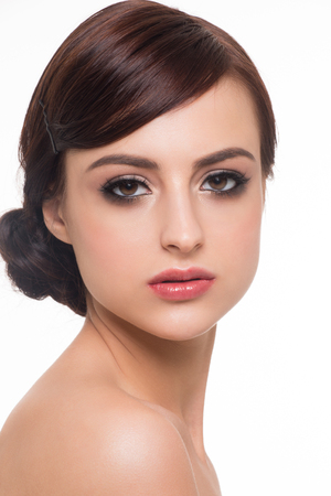 lips glow: Portrait of young beautiful woman with fashion makeup. Makeup with golden eyeshadow and red lips Stock Photo