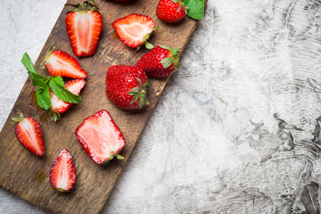 sappy: Fresh red strawberry with fresh mint on a wooden cutting board