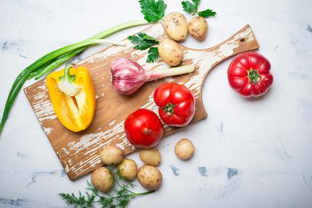 Fresh organic vegetables on a wooden cutting board