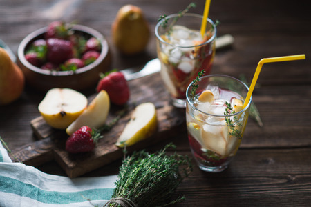 juice bar: Cocktail with fresh sweet pears and thyme in glass on a dark wooden background Stock Photo