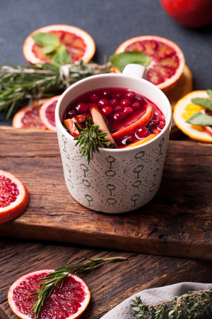 apple cinnamon: Mulled wine with slice of red orange, fresh rosemary and spices. Glass with hot drink