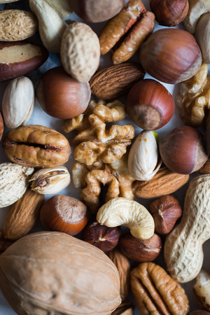 scattering: Assorted nuts, close-up view Stock Photo
