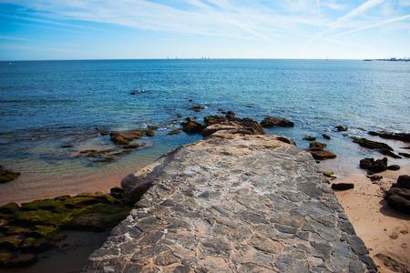 Beautiful view of the coast, Atlantic Ocean, Portugal. Empty pier near the ocean Stock Photo