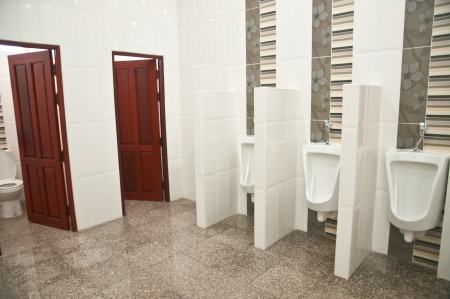 Automatic urinals in a modern toilet photo