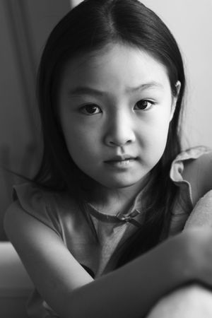 black and white portrait of an eight-year old asian girl photo