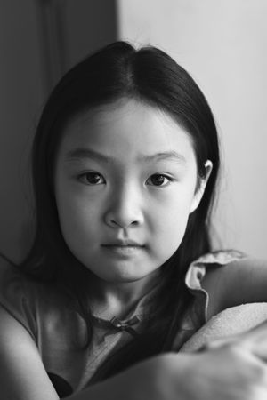 8 year old: black and white portrait of an eight-year old asian girl Stock Photo