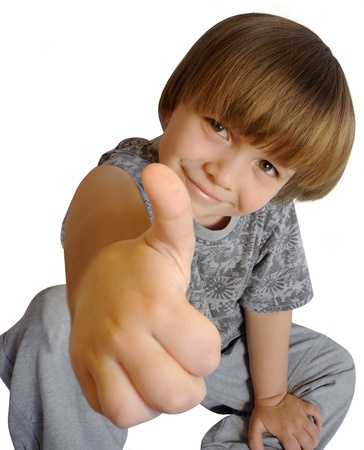 Portrait of beautiful little boy giving you thumbs up