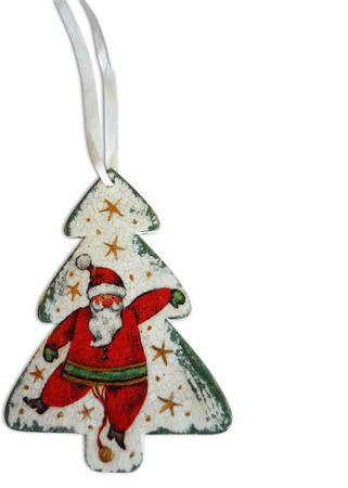 Cheerful Santa Claus on a Christmas tree on an isolated background Stock Photo
