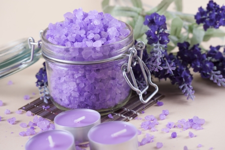 Aromatherapy and relaxation - colorful lavender bath salt in a glass