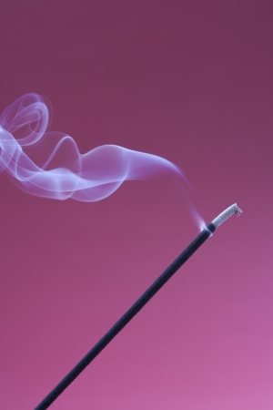 excersise: Aromatherpay ideas - burning incense with smoke over a purple background