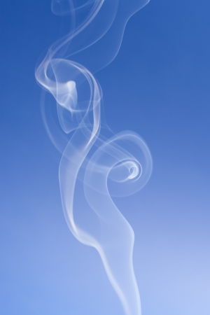 solid blue background: An abstract photo close up - solid blue background with a smokes swirls