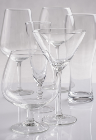 Alcohol glasses over a solid bright background photo
