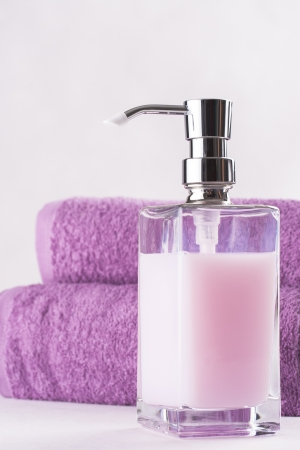 liquid soap: Be clean - fresh and clean - bottle of a violet liquid soap Stock Photo