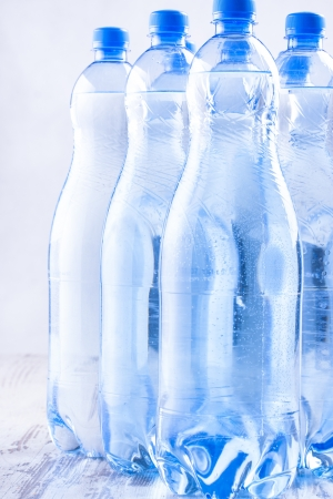 solid blue background: Couple of sparkling water blue bottles composition on a bright solid background.