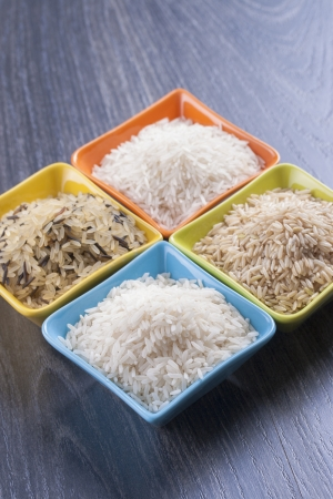 staple food: Close up photo of food ingredients - staple food - a bowls full of a rice. Stock Photo