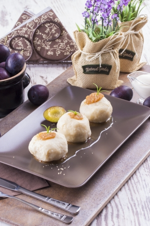 central european: Central European cuisine - sweet meal - cooked dumplings with a plums.