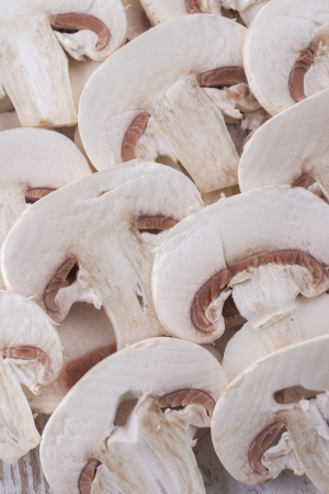 agaricus: A close up photo of sliced edible mushrooms known as Agaricus.