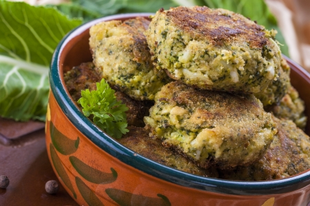 Exotic dinner - broccoli chops with mixed eggs and bread crumbs placed in the brown clay pot
