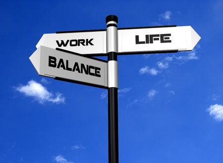Work Life Balance Image of a signpost offering the directions to work and life, with balance between the two  photo