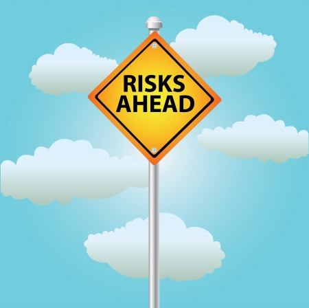 Risk ahead signpost on sky background