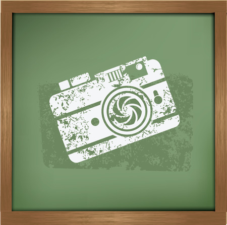 digicam: Camera on blackboard background,grunge vector