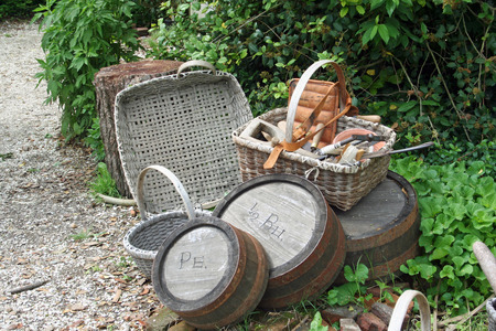 Traditional tools and baskets in colonial garden