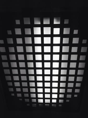 sieve: Ceiling sieve in monochrome