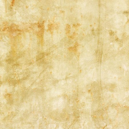 Old grunge distressed paper with rust spots Фото со стока