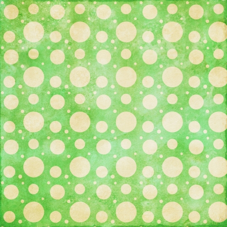 Retro grunge background in cream and green with dots