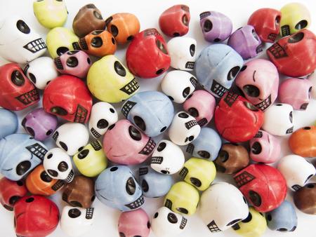 Bright background of toy skulls
