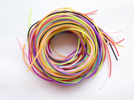 tangling: beam of multicolored cords that form a spiral