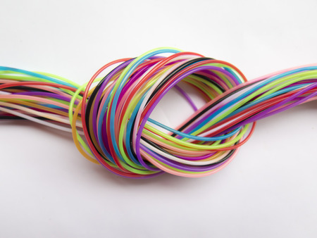 node: ropes form a beautiful multi-colored node Stock Photo