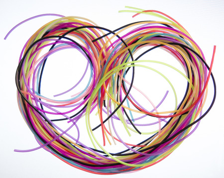 The heart of the colored wires on white background