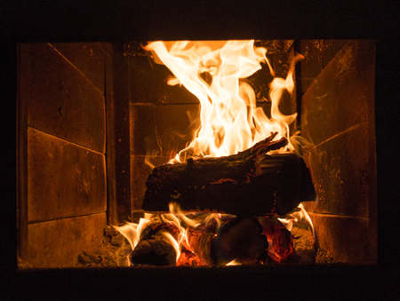 burning fireplace: Burning fireplace, firewood, evening warmth and comfort