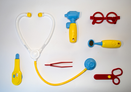 pediatric: Fun background about pediatric medicine with color toys Stock Photo