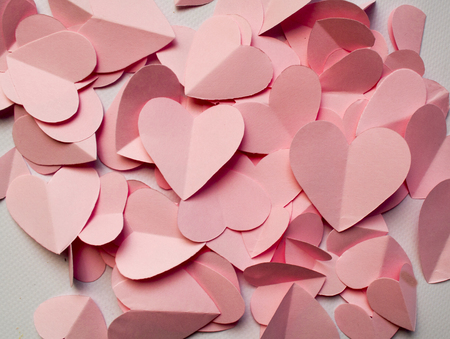 a lot: lot cut from pink paper hearts