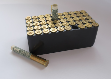 38 caliber: cassette with 38 caliber ammunition, and money , on a white background us dollar