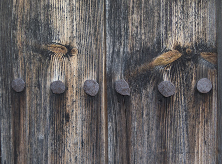 clavados: Background of the old wooden light boards with nails