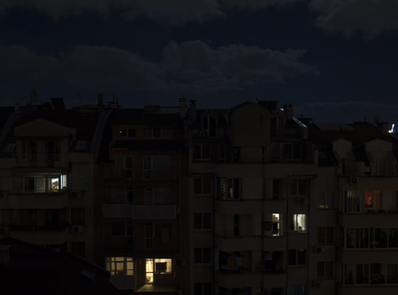 lowrise: Glowing Windows in low-rise building in vs Stock Photo