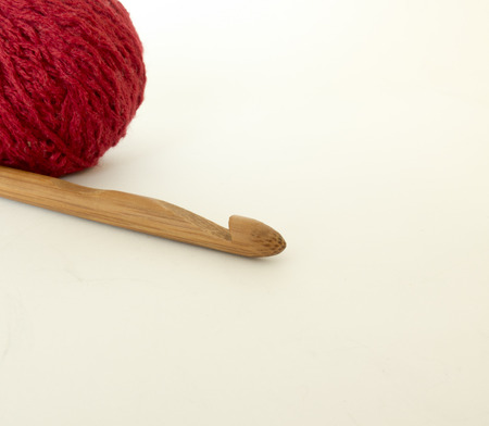 Background on needlework with crochet hook and balls of wool