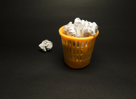 Full trash can on a black background Stock Photo