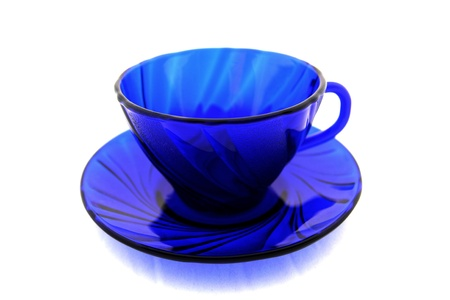 housewares: Empty dark blue cup with a saucer on a white background