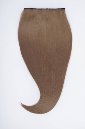 Straight virgin remy virgin human hair clip in extensionson light grey background Banque d'images