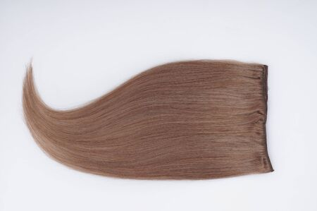 Straight virgin remy human hair clip in extensions on light grey background