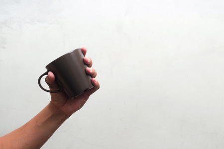 Empty coffee Cup in Hand